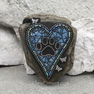 Blue mosaic heart with paw print.